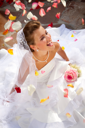 Woman Wearing Wedding Veil Laughing